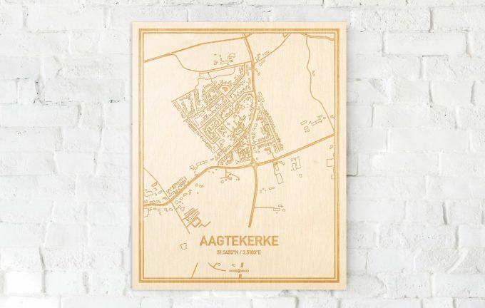 De kaart Aagtekerke aan een witte bakstenen muur. Prachtige persoonlijke muurdecoratie. Lasers graveren Aagtekerke haar straten, buurten en huizen waardoor een schitterende plaats in Zeeland mooi in kaart gebracht wordt.
