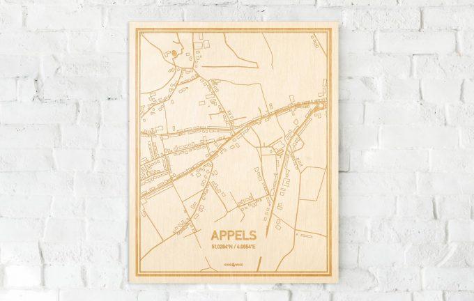 De kaart Appels aan een witte bakstenen muur. Prachtige persoonlijke muurdecoratie. Lasers graveren Appels haar straten, buurten en huizen waardoor een opvallende plaats in Oost-Vlaanderen  mooi in kaart gebracht wordt.