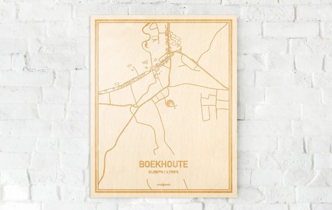 De kaart Boekhoute aan een witte bakstenen muur. Prachtige persoonlijke muurdecoratie. Lasers graveren Boekhoute haar straten, buurten en huizen waardoor een unieke plaats in Oost-Vlaanderen  mooi in kaart gebracht wordt.