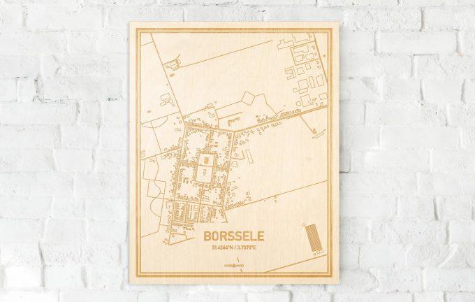De kaart Borssele aan een witte bakstenen muur. Prachtige persoonlijke muurdecoratie. Lasers graveren Borssele haar straten, buurten en huizen waardoor een prachtige plaats in Zeeland mooi in kaart gebracht wordt.