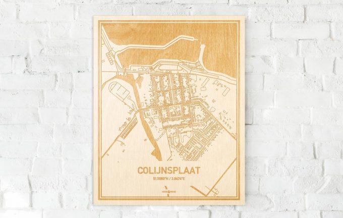 De kaart Colijnsplaat aan een witte bakstenen muur. Prachtige persoonlijke muurdecoratie. Lasers graveren Colijnsplaat haar straten, buurten en huizen waardoor een verrassende plaats in Zeeland mooi in kaart gebracht wordt.