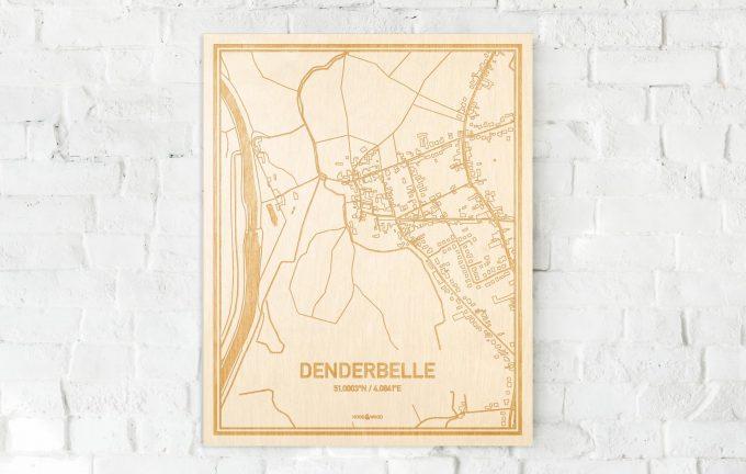 De kaart Denderbelle aan een witte bakstenen muur. Prachtige persoonlijke muurdecoratie. Lasers graveren Denderbelle haar straten, buurten en huizen waardoor een verrassende plaats in Oost-Vlaanderen  mooi in kaart gebracht wordt.