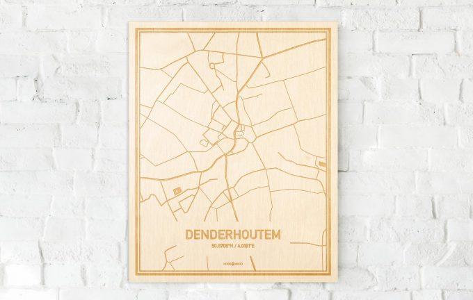 De kaart Denderhoutem aan een witte bakstenen muur. Prachtige persoonlijke muurdecoratie. Lasers graveren Denderhoutem haar straten, buurten en huizen waardoor een opvallende plaats in Oost-Vlaanderen  mooi in kaart gebracht wordt.