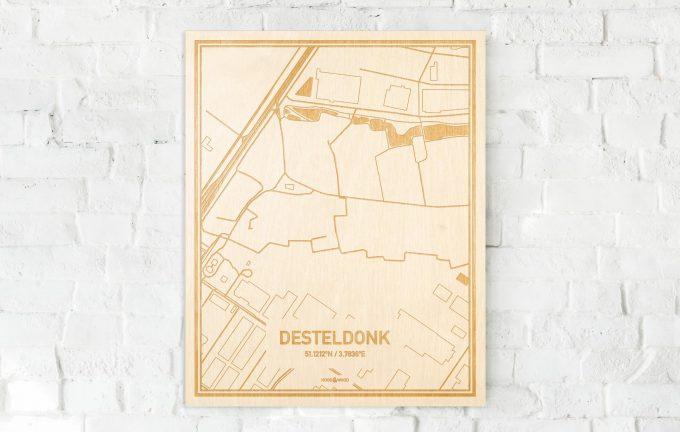 De kaart Desteldonk aan een witte bakstenen muur. Prachtige persoonlijke muurdecoratie. Lasers graveren Desteldonk haar straten, buurten en huizen waardoor een prachtige plaats in Oost-Vlaanderen  mooi in kaart gebracht wordt.