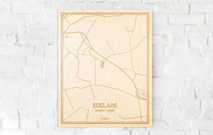 De kaart Edelare aan een witte bakstenen muur. Prachtige persoonlijke muurdecoratie. Lasers graveren Edelare haar straten, buurten en huizen waardoor een speciale plaats in Oost-Vlaanderen  mooi in kaart gebracht wordt.
