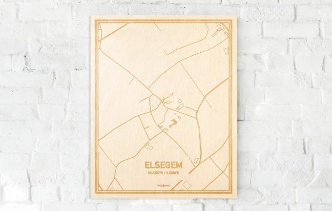 De kaart Elsegem aan een witte bakstenen muur. Prachtige persoonlijke muurdecoratie. Lasers graveren Elsegem haar straten, buurten en huizen waardoor een speciale plaats in Oost-Vlaanderen  mooi in kaart gebracht wordt.