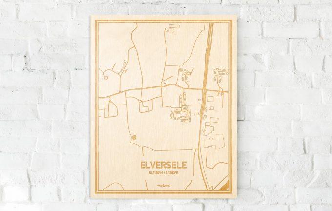 De kaart Elversele aan een witte bakstenen muur. Prachtige persoonlijke muurdecoratie. Lasers graveren Elversele haar straten, buurten en huizen waardoor een moderne plaats in Oost-Vlaanderen  mooi in kaart gebracht wordt.