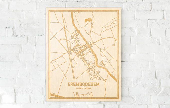 De kaart Erembodegem aan een witte bakstenen muur. Prachtige persoonlijke muurdecoratie. Lasers graveren Erembodegem haar straten, buurten en huizen waardoor een moderne plaats in Oost-Vlaanderen  mooi in kaart gebracht wordt.