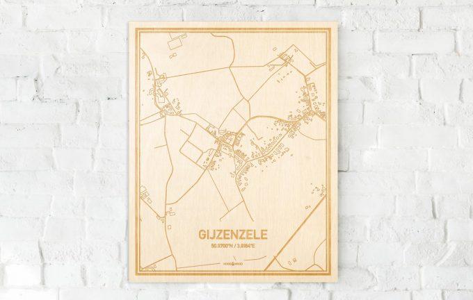 De kaart Gijzenzele aan een witte bakstenen muur. Prachtige persoonlijke muurdecoratie. Lasers graveren Gijzenzele haar straten, buurten en huizen waardoor een speciale plaats in Oost-Vlaanderen  mooi in kaart gebracht wordt.