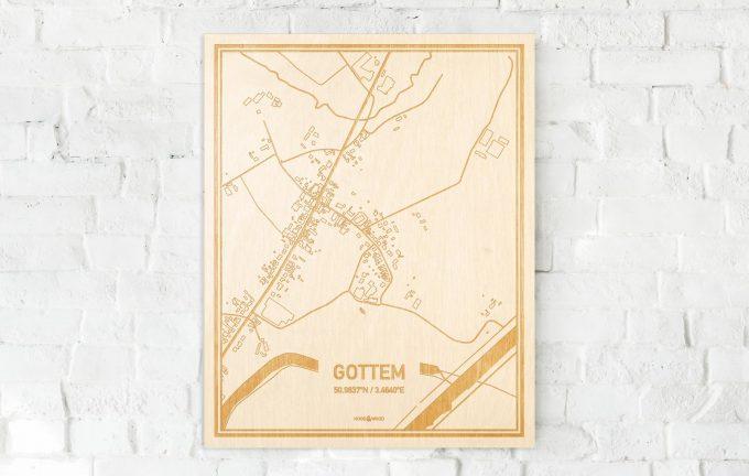 De kaart Gottem aan een witte bakstenen muur. Prachtige persoonlijke muurdecoratie. Lasers graveren Gottem haar straten, buurten en huizen waardoor een moderne plaats in Oost-Vlaanderen  mooi in kaart gebracht wordt.