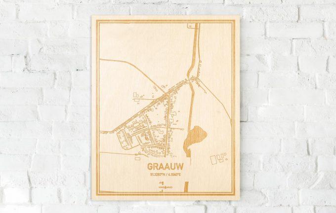 De kaart Graauw aan een witte bakstenen muur. Prachtige persoonlijke muurdecoratie. Lasers graveren Graauw haar straten, buurten en huizen waardoor een speciale plaats in Zeeland mooi in kaart gebracht wordt.