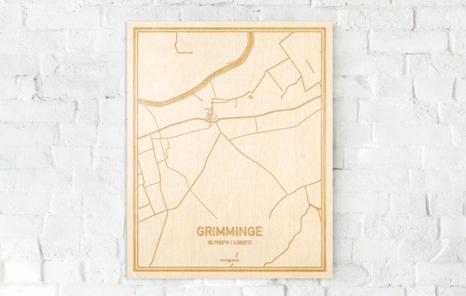 De kaart Grimminge aan een witte bakstenen muur. Prachtige persoonlijke muurdecoratie. Lasers graveren Grimminge haar straten, buurten en huizen waardoor een verrassende plaats in Oost-Vlaanderen  mooi in kaart gebracht wordt.