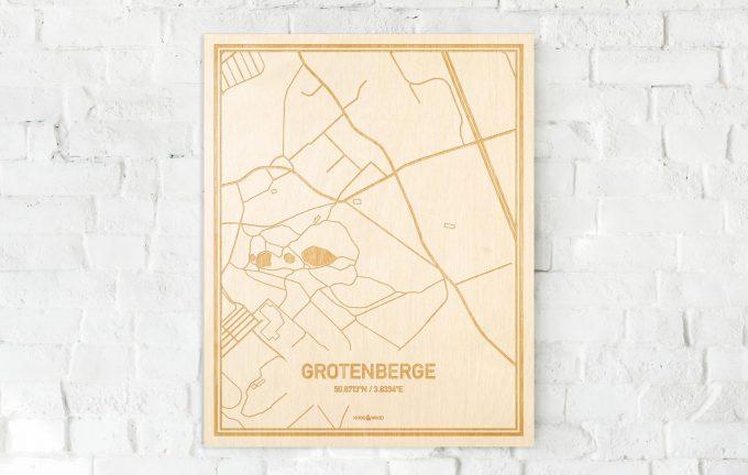 De kaart Grotenberge aan een witte bakstenen muur. Prachtige persoonlijke muurdecoratie. Lasers graveren Grotenberge haar straten, buurten en huizen waardoor een verrassende plaats in Oost-Vlaanderen  mooi in kaart gebracht wordt.
