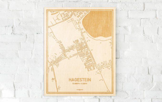 De kaart Hagestein aan een witte bakstenen muur. Prachtige persoonlijke muurdecoratie. Lasers graveren Hagestein haar straten, buurten en huizen waardoor een verrassende plaats in Utrecht mooi in kaart gebracht wordt.