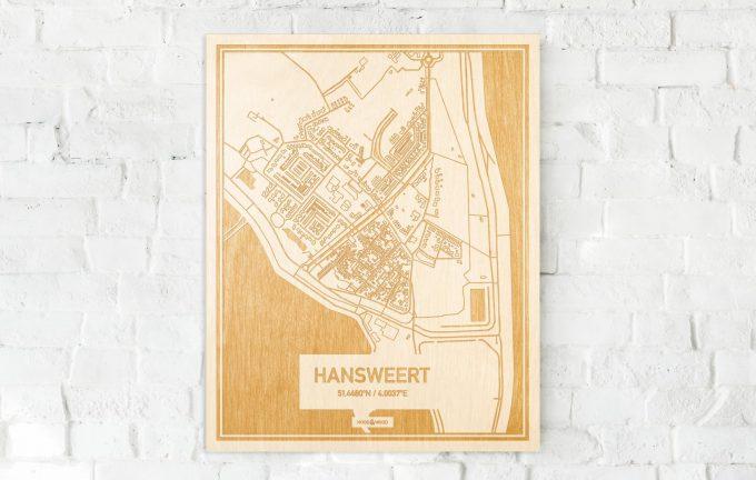 De kaart Hansweert aan een witte bakstenen muur. Prachtige persoonlijke muurdecoratie. Lasers graveren Hansweert haar straten, buurten en huizen waardoor een schitterende plaats in Zeeland mooi in kaart gebracht wordt.
