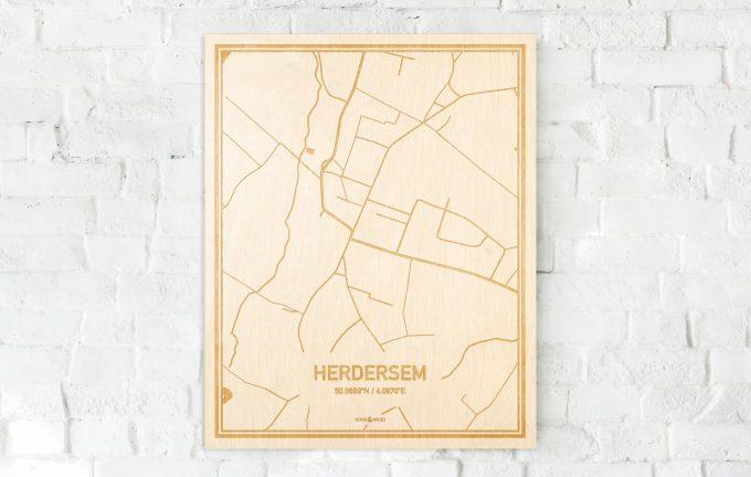 De kaart Herdersem aan een witte bakstenen muur. Prachtige persoonlijke muurdecoratie. Lasers graveren Herdersem haar straten, buurten en huizen waardoor een moderne plaats in Oost-Vlaanderen  mooi in kaart gebracht wordt.