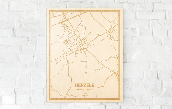 De kaart Herzele aan een witte bakstenen muur. Prachtige persoonlijke muurdecoratie. Lasers graveren Herzele haar straten, buurten en huizen waardoor een speciale plaats in Oost-Vlaanderen  mooi in kaart gebracht wordt.