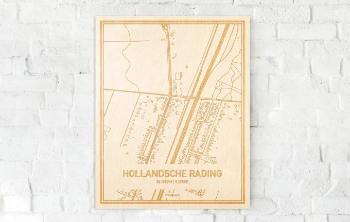 De kaart Hollandsche Rading aan een witte bakstenen muur. Prachtige persoonlijke muurdecoratie. Lasers graveren Hollandsche Rading haar straten, buurten en huizen waardoor een stijlvolle plaats in Utrecht mooi in kaart gebracht wordt.