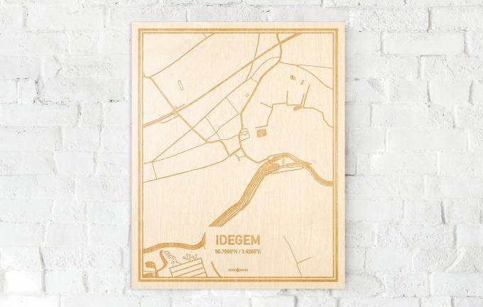 De kaart Idegem aan een witte bakstenen muur. Prachtige persoonlijke muurdecoratie. Lasers graveren Idegem haar straten, buurten en huizen waardoor een unieke plaats in Oost-Vlaanderen  mooi in kaart gebracht wordt.