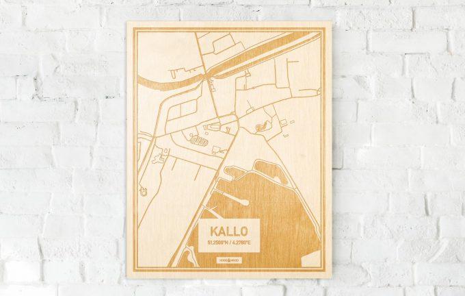 De kaart Kallo aan een witte bakstenen muur. Prachtige persoonlijke muurdecoratie. Lasers graveren Kallo haar straten, buurten en huizen waardoor een bijzondere plaats in Oost-Vlaanderen  mooi in kaart gebracht wordt.