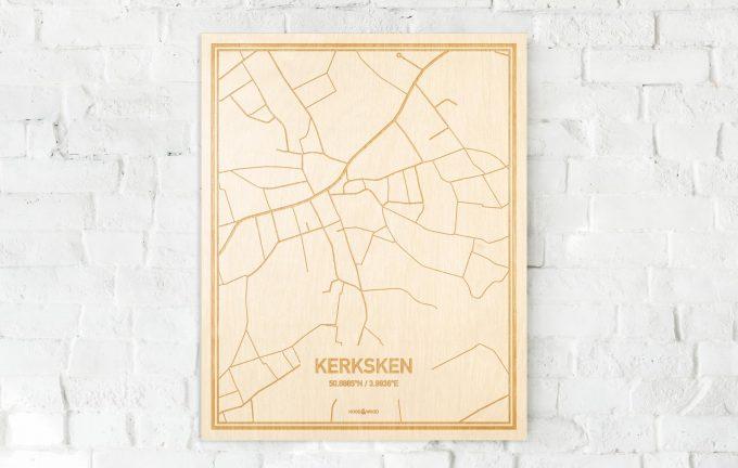 De kaart Kerksken aan een witte bakstenen muur. Prachtige persoonlijke muurdecoratie. Lasers graveren Kerksken haar straten, buurten en huizen waardoor een originele plaats in Oost-Vlaanderen  mooi in kaart gebracht wordt.
