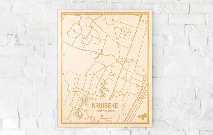 De kaart Kruibeke aan een witte bakstenen muur. Prachtige persoonlijke muurdecoratie. Lasers graveren Kruibeke haar straten, buurten en huizen waardoor een speciale plaats in Oost-Vlaanderen  mooi in kaart gebracht wordt.