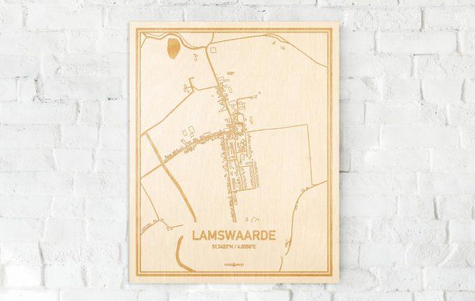 De kaart Lamswaarde aan een witte bakstenen muur. Prachtige persoonlijke muurdecoratie. Lasers graveren Lamswaarde haar straten, buurten en huizen waardoor een schitterende plaats in Zeeland mooi in kaart gebracht wordt.