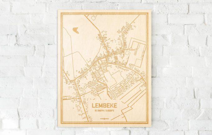 De kaart Lembeke aan een witte bakstenen muur. Prachtige persoonlijke muurdecoratie. Lasers graveren Lembeke haar straten, buurten en huizen waardoor een schitterende plaats in Oost-Vlaanderen  mooi in kaart gebracht wordt.