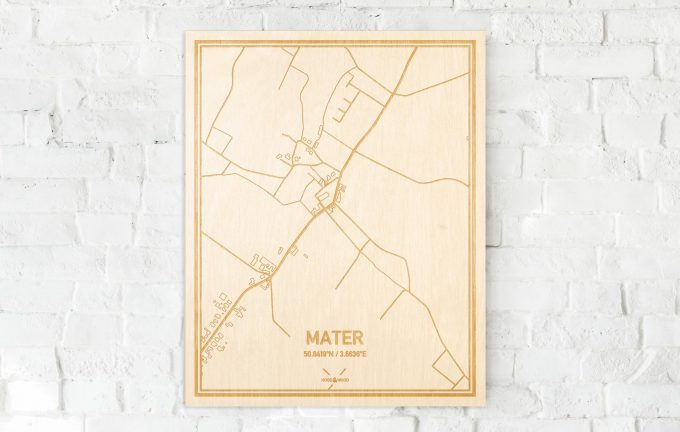 De kaart Mater aan een witte bakstenen muur. Prachtige persoonlijke muurdecoratie. Lasers graveren Mater haar straten, buurten en huizen waardoor een verrassende plaats in Oost-Vlaanderen  mooi in kaart gebracht wordt.