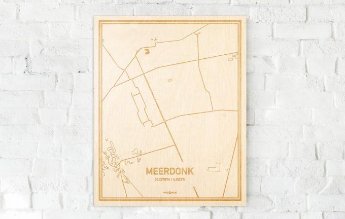 De kaart Meerdonk aan een witte bakstenen muur. Prachtige persoonlijke muurdecoratie. Lasers graveren Meerdonk haar straten, buurten en huizen waardoor een schitterende plaats in Oost-Vlaanderen  mooi in kaart gebracht wordt.