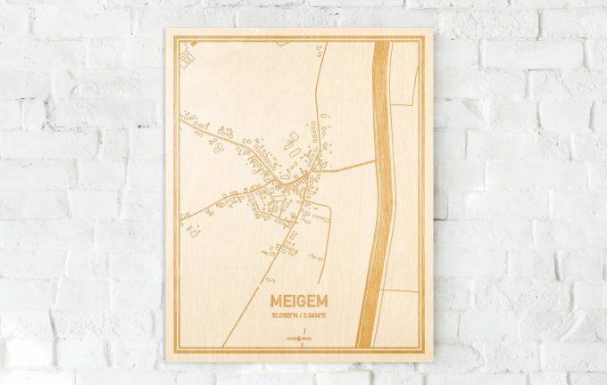 De kaart Meigem aan een witte bakstenen muur. Prachtige persoonlijke muurdecoratie. Lasers graveren Meigem haar straten, buurten en huizen waardoor een speciale plaats in Oost-Vlaanderen  mooi in kaart gebracht wordt.