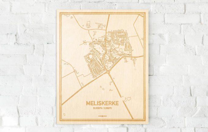 De kaart Meliskerke aan een witte bakstenen muur. Prachtige persoonlijke muurdecoratie. Lasers graveren Meliskerke haar straten, buurten en huizen waardoor een unieke plaats in Zeeland mooi in kaart gebracht wordt.