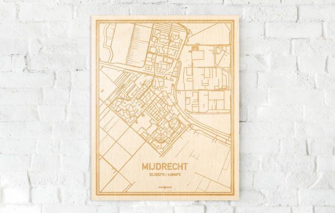 De kaart Mijdrecht aan een witte bakstenen muur. Prachtige persoonlijke muurdecoratie. Lasers graveren Mijdrecht haar straten, buurten en huizen waardoor een speciale plaats in Utrecht mooi in kaart gebracht wordt.