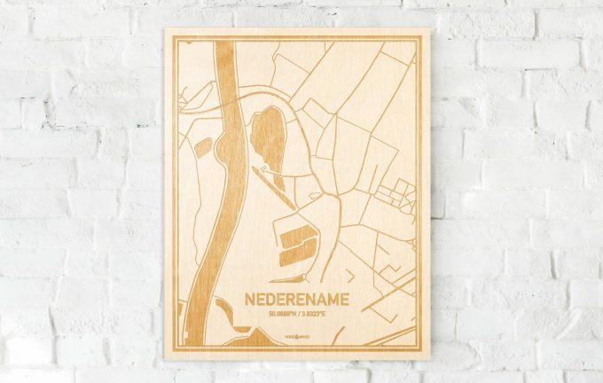 De kaart Nederename aan een witte bakstenen muur. Prachtige persoonlijke muurdecoratie. Lasers graveren Nederename haar straten, buurten en huizen waardoor een schitterende plaats in Oost-Vlaanderen  mooi in kaart gebracht wordt.