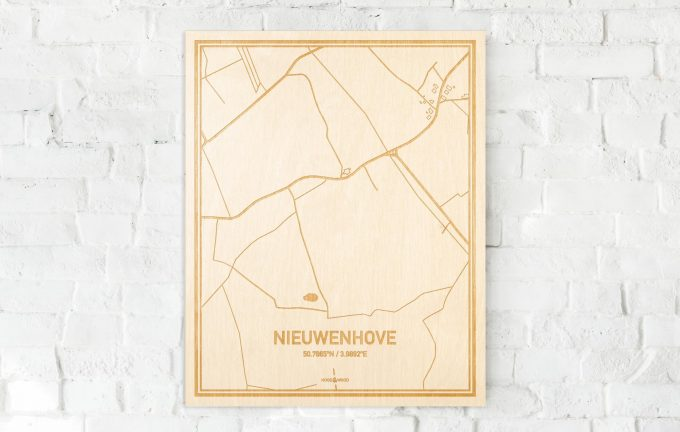 De kaart Nieuwenhove aan een witte bakstenen muur. Prachtige persoonlijke muurdecoratie. Lasers graveren Nieuwenhove haar straten, buurten en huizen waardoor een verrassende plaats in Oost-Vlaanderen  mooi in kaart gebracht wordt.