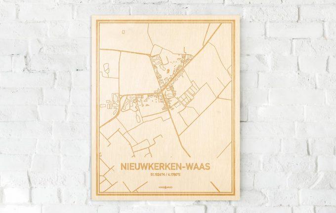 De kaart Nieuwkerken-Waas aan een witte bakstenen muur. Prachtige persoonlijke muurdecoratie. Lasers graveren Nieuwkerken-Waas haar straten, buurten en huizen waardoor een stijlvolle plaats in Oost-Vlaanderen  mooi in kaart gebracht wordt.
