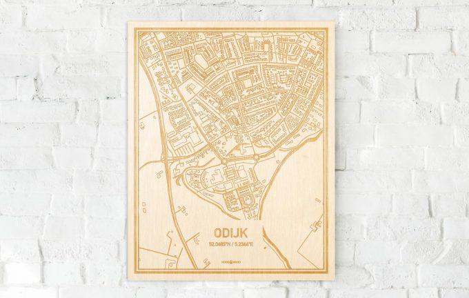 De kaart Odijk aan een witte bakstenen muur. Prachtige persoonlijke muurdecoratie. Lasers graveren Odijk haar straten, buurten en huizen waardoor een moderne plaats in Utrecht mooi in kaart gebracht wordt.
