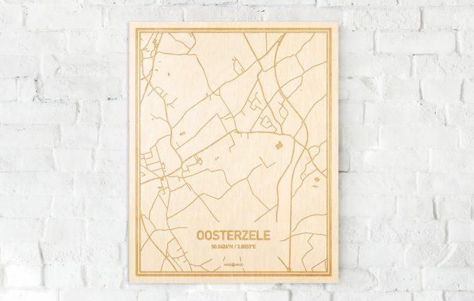 De kaart Oosterzele aan een witte bakstenen muur. Prachtige persoonlijke muurdecoratie. Lasers graveren Oosterzele haar straten, buurten en huizen waardoor een unieke plaats in Oost-Vlaanderen  mooi in kaart gebracht wordt.