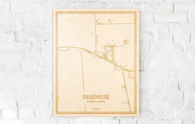 De kaart Ossenisse aan een witte bakstenen muur. Prachtige persoonlijke muurdecoratie. Lasers graveren Ossenisse haar straten, buurten en huizen waardoor een verrassende plaats in Zeeland mooi in kaart gebracht wordt.