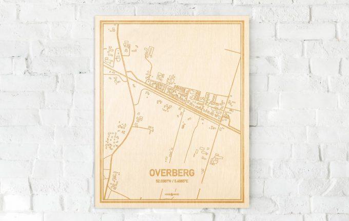 De kaart Overberg aan een witte bakstenen muur. Prachtige persoonlijke muurdecoratie. Lasers graveren Overberg haar straten, buurten en huizen waardoor een speciale plaats in Utrecht mooi in kaart gebracht wordt.