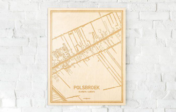 De kaart Polsbroek aan een witte bakstenen muur. Prachtige persoonlijke muurdecoratie. Lasers graveren Polsbroek haar straten, buurten en huizen waardoor een prachtige plaats in Utrecht mooi in kaart gebracht wordt.
