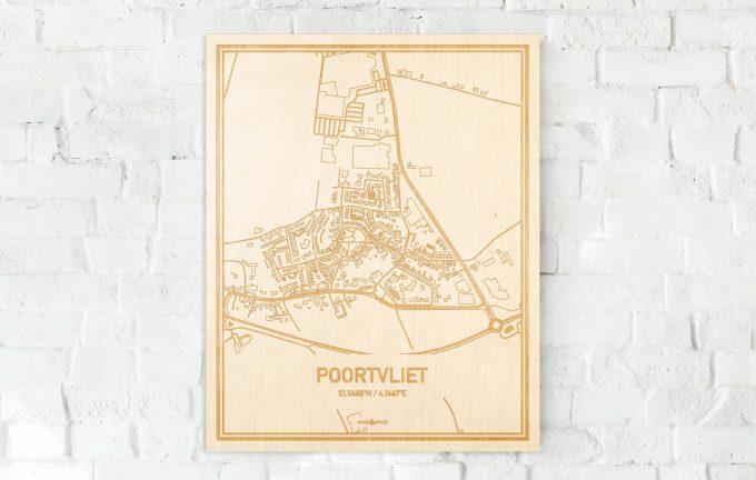 De kaart Poortvliet aan een witte bakstenen muur. Prachtige persoonlijke muurdecoratie. Lasers graveren Poortvliet haar straten, buurten en huizen waardoor een prachtige plaats in Zeeland mooi in kaart gebracht wordt.