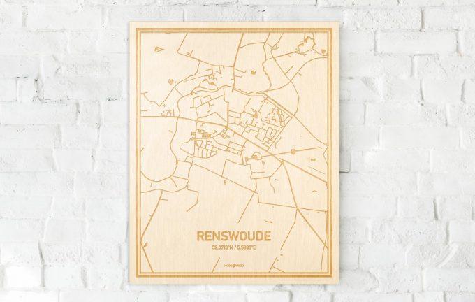 De kaart Renswoude aan een witte bakstenen muur. Prachtige persoonlijke muurdecoratie. Lasers graveren Renswoude haar straten, buurten en huizen waardoor een prachtige plaats in Utrecht mooi in kaart gebracht wordt.