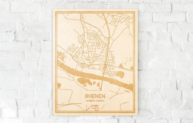 De kaart Rhenen aan een witte bakstenen muur. Prachtige persoonlijke muurdecoratie. Lasers graveren Rhenen haar straten, buurten en huizen waardoor een opvallende plaats in Utrecht mooi in kaart gebracht wordt.