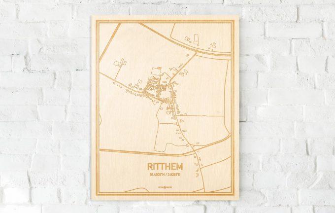 De kaart Ritthem aan een witte bakstenen muur. Prachtige persoonlijke muurdecoratie. Lasers graveren Ritthem haar straten, buurten en huizen waardoor een schitterende plaats in Zeeland mooi in kaart gebracht wordt.
