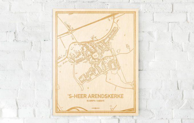 De kaart 's-Heer Arendskerke aan een witte bakstenen muur. Prachtige persoonlijke muurdecoratie. Lasers graveren 's-Heer Arendskerke haar straten, buurten en huizen waardoor een verrassende plaats in Zeeland mooi in kaart gebracht wordt.