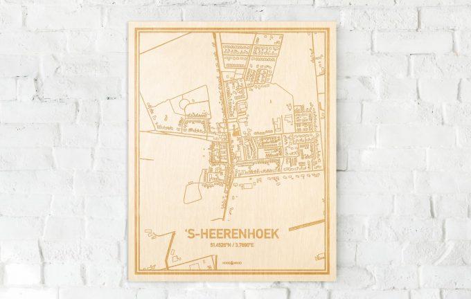 De kaart 's-Heerenhoek aan een witte bakstenen muur. Prachtige persoonlijke muurdecoratie. Lasers graveren 's-Heerenhoek haar straten, buurten en huizen waardoor een moderne plaats in Zeeland mooi in kaart gebracht wordt.