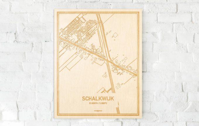 De kaart Schalkwijk aan een witte bakstenen muur. Prachtige persoonlijke muurdecoratie. Lasers graveren Schalkwijk haar straten, buurten en huizen waardoor een verrassende plaats in Utrecht mooi in kaart gebracht wordt.