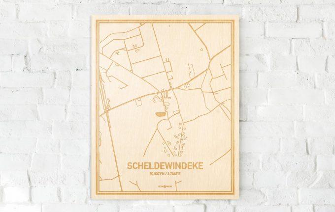 De kaart Scheldewindeke aan een witte bakstenen muur. Prachtige persoonlijke muurdecoratie. Lasers graveren Scheldewindeke haar straten, buurten en huizen waardoor een originele plaats in Oost-Vlaanderen  mooi in kaart gebracht wordt.
