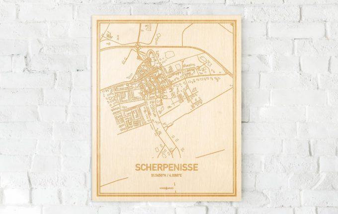 De kaart Scherpenisse aan een witte bakstenen muur. Prachtige persoonlijke muurdecoratie. Lasers graveren Scherpenisse haar straten, buurten en huizen waardoor een bijzondere plaats in Zeeland mooi in kaart gebracht wordt.